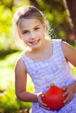 Girl with red kuri squash Royalty Free Stock Image
