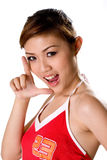 Girl in red with L shape hands. Beautiful girl in tank top with mouth open and hand shape L with number 23 on the tank top Stock Photo