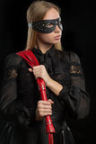 Girl with red leather whip and mask BDSM Royalty Free Stock Photo
