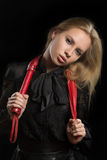 Girl with red leather whip. Portrait of a girl with red leather whip Royalty Free Stock Image