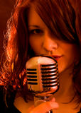 Girl with red lights, singing Royalty Free Stock Photos