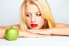 Girl with red lips and green apple Stock Photos