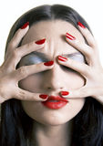 Girl with red lips and nails. Image of a girl with bright red makeup Royalty Free Stock Photos
