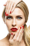 Girl with red lips and nails Stock Photos