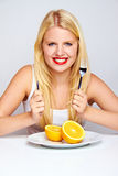 Girl with red lips and an orange Royalty Free Stock Image