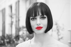 Girl with red lips on sensual face in paris, france. Wowan with stylish hair. Beauty salon concept. Look, visage, hairstyle, black and white girl vintage style Stock Images