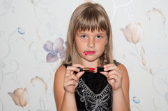 Girl with red lipstick in hand. And red make up Stock Photo