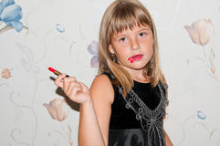 Girl with red lipstick in hand. And red make up Stock Photography