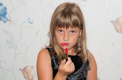 Girl with red lipstick in hand. And red make up Stock Images