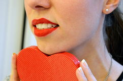 Girl with red lipstick and present box Royalty Free Stock Image