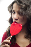 Girl with red lollipop Royalty Free Stock Images