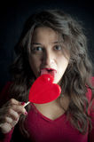 Girl with red lollipop Stock Photos