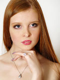 Girl with red long hair Stock Images