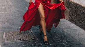 The girl in the red. Long, slender legs royalty free stock images