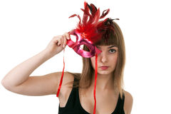 Girl in the red masquerade mask Stock Images