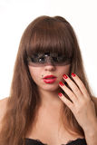 Girl with red nails. Beautiful young girl with her hand over her face and blindfold, over white background royalty free stock photos