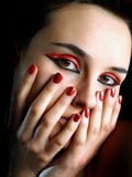 a girl with red nails Stock Images