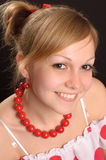 Girl in red necklace Stock Image