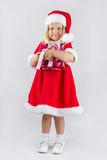 Girl in a red new year cap Royalty Free Stock Photo