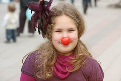 Girl with red nose Stock Photo