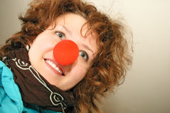 Girl with red nose. Cheerful girl with red nose Stock Image