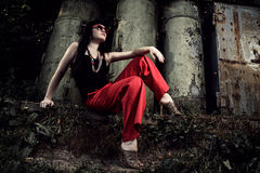 Girl in red pants and glasses Royalty Free Stock Images