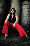 Stylish girl in red pants and glasses Royalty Free Stock Image