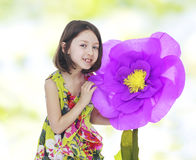 Girl in a red paper flower. Stock Photo