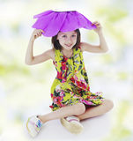 Girl in a red paper flower. Royalty Free Stock Photos
