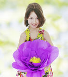 Girl in a red paper flower. Stock Image