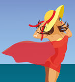 Girl in red pareo. Against the sea Royalty Free Stock Photo