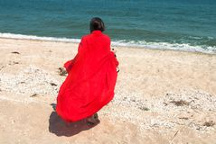 Girl in red pareo on the beach Royalty Free Stock Photography