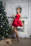 Girl in red party dress near new year tree Stock Image