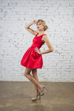 Girl in red party dress Stock Photo