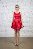 Girl in red party dress Stock Photos