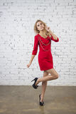 Girl in red party dress Stock Images