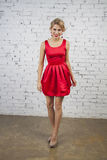 Girl in red party dress Royalty Free Stock Images