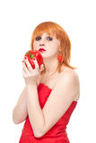 Girl with red pepper lookin strainght ,isolated stock photo