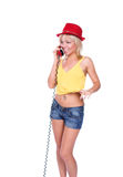 The girl and the red phone Royalty Free Stock Photos