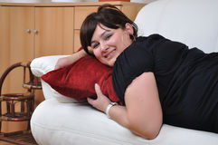 Girl on red pillow stock photos