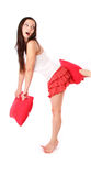 Girl in red with pillow Royalty Free Stock Photo