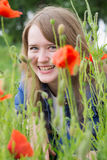 Girl with red poppies Royalty Free Stock Photos