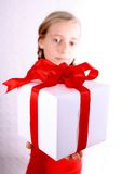 Girl in red and present Royalty Free Stock Photography