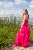 Girl Red Prom Dress By Tall Reeds Royalty Free Stock Images