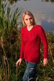 Girl in red pullover Royalty Free Stock Image