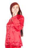 Girl in red pyjamas keeping silent sign Stock Images