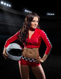 Girl in red racing costume at stadium Royalty Free Stock Photos