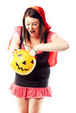 Girl in red riding hood costume pulling out treats Stock Images