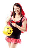 Girl in red riding hood costume pulling out treats Stock Photos