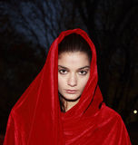 Girl in red robe. A young girl wearing a red robe or cloak as she visits Central Park in New York City. She is Portuguese and in her twenties. Image taken Stock Images